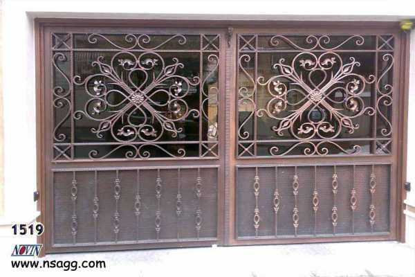 درب فلزی خیلی شیک و زیبا با گل های فرفروژه مناسب برای درب ورودی ساختمان , حیاط و پارکینگ کد ۲۶۱