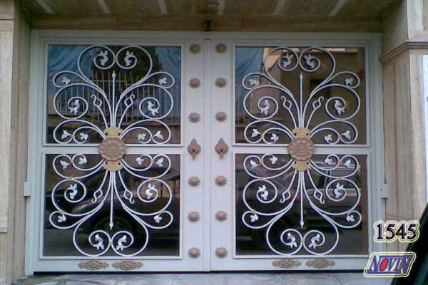 درب فلزی بسیار شیک و زیبا با گلهای فرفروزه مناسب برای ورودی ساختمان ,حیاط و پارکینگ کد ۲۶۴